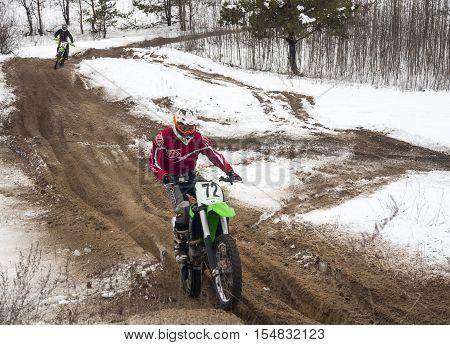 KYIV UKRAINE - FEBRUARY 15 2015: Motorcyclists training on a winter race track.