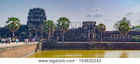 Siem Reap, Cambodia - February 1, 2016: Unidentified tourists visit to Angkor Wat temple Siem Reap Cambodia. The main entrance to the fortress.