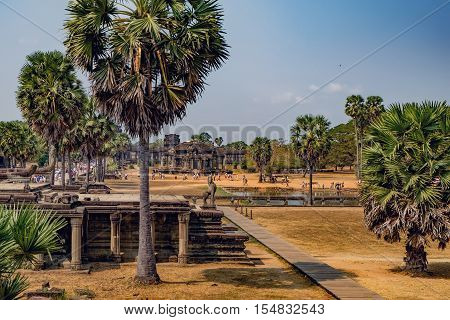 Siem Reap, Cambodia - February 1, 2016: Unidentified tourists visit to Angkor Wat temple Siem Reap Cambodia. The main road to Angkor Wat which runs tours