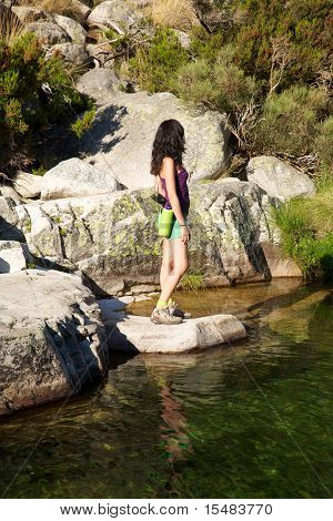 Side Woman On A Rock Watching River