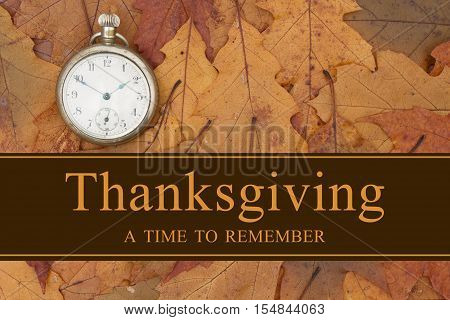 A Thanksgiving message Some fall leaves and retro pocket watch with text Thanksgiving a time to remember
