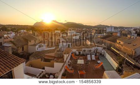 Panorama of Alcudia Old Town in Majorca Mallorca Balearic island of Spain. Beautiful Sunrise townscape.