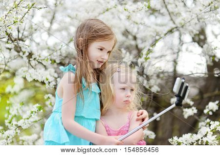 Two Little Sisters Taking A Photo Of Themself