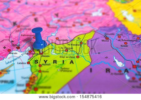 Aleppo in Syria pinned on colorful political map of Europe. Geopolitical school atlas. Tilt shift effect.