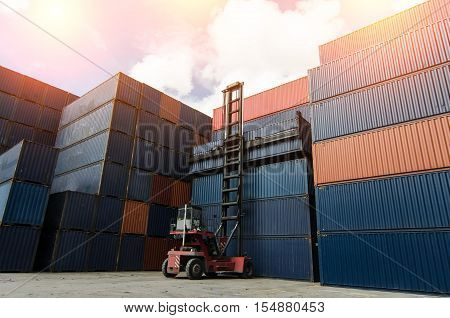 Toplift handling container box in shipyard at dusk for Logistic Import Export background