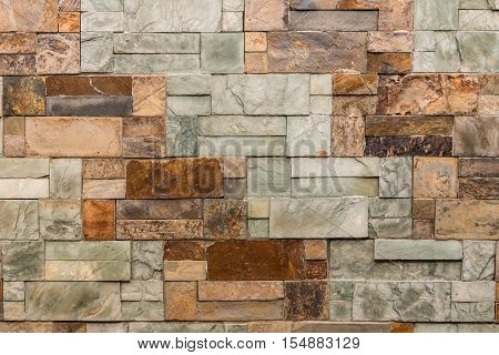 closeup of uneven marble blocks wall background