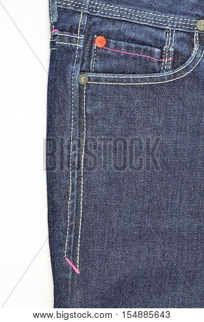 Blue jeans front pocket and side seam isolated on white background