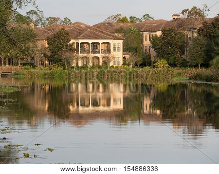 Condos refecting on the glass like pond in Celbration Florida