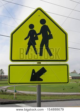 A Reflective School Crosswalk Sign in a residential area in Lake Wales Florida