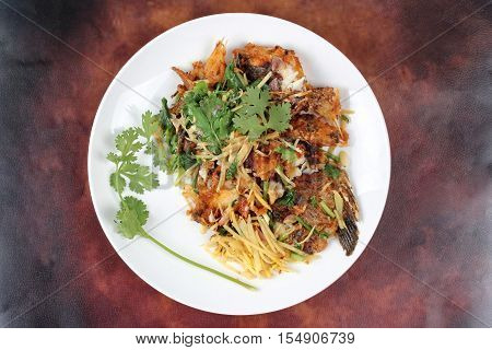 Fried ginger with Tilapia fish  (Call Pla Nil Pad Khing in Thai)