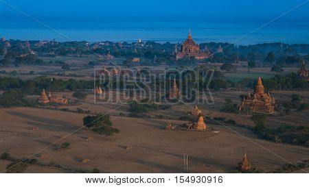 Ballooning in the dawn over Bagan a thousands of stupas Myanmar