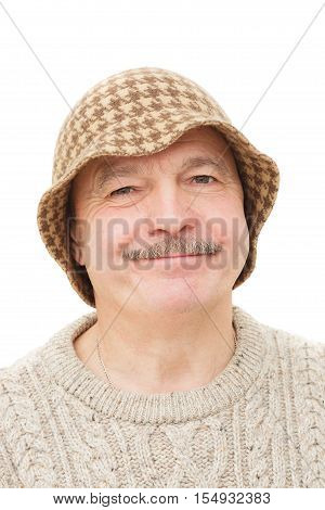 Elderly Man In A Funny Hat With Suspicion And Disdain Looking At The Camera