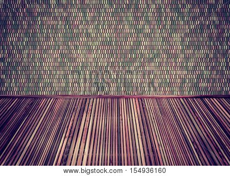 Empty Room With Thatch Floor And Colorful Ceramic Tiles Wall.