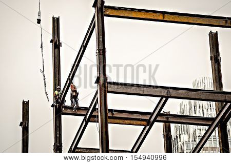 Construction Worker Working On Highrise Building