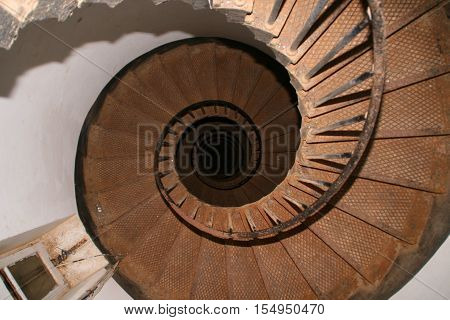 Upside view of a spiral staircase at lighthouse Big Brother island
