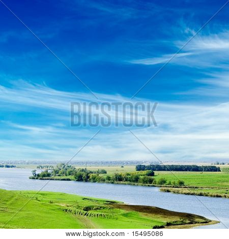 The wide river, green coast, the blue sky.