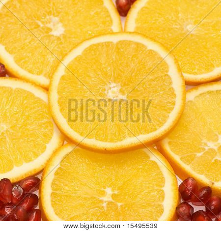 Fruit background from a orange and seeds of a pomegranate.