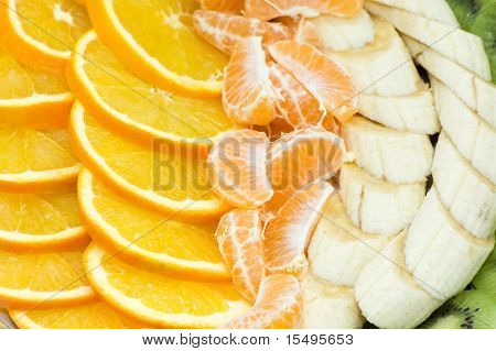 The cut bananas, oranges, tangerines,