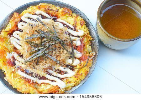 Japanese food okonomiyaki , Japanese pizza. Traditional food in Hiroshima, Japan