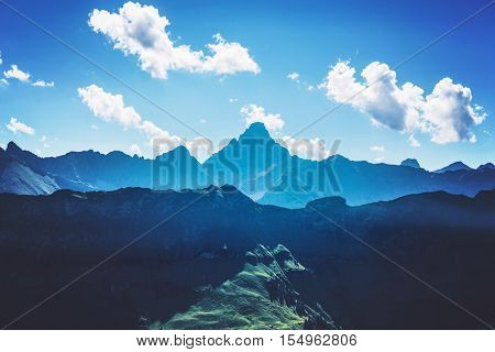 Mountains in shadows and sunlight of the Alps near Allgau Germany under blue sky