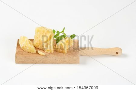 parmesan cheese and oregano on wooden grater