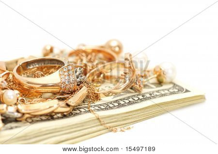 Gold ornaments and dollars isolated on a white background.