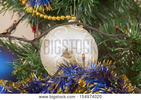 colorful Christmas decorations hung on the branches of trees