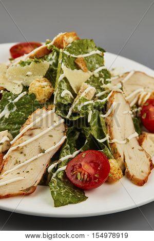 Caesar salad fresh vegetable salad close-up macro photo