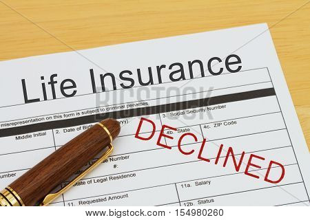 Applying for a Life Insurance Declined Life Insurance application form with a pen on a desk with an declined stamp