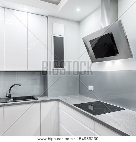 Light Kitchen With Exhaust Hood And Hob