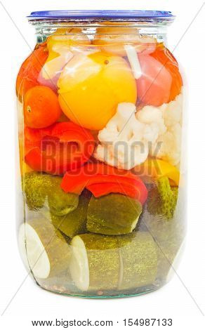 Marinated vegetables (bellpepper tomato cucumber garlic cauliflower) in a glass jar isolated on white background.