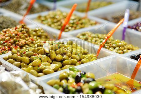 Assorted Olives On Farmer's Market In Italy