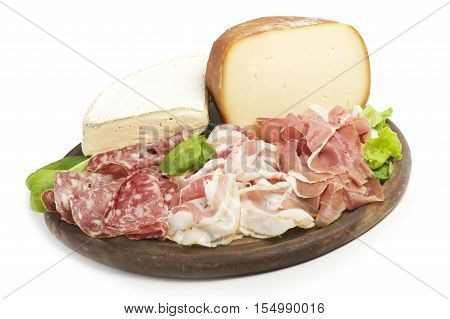 wooden cutting board with salami and cheese