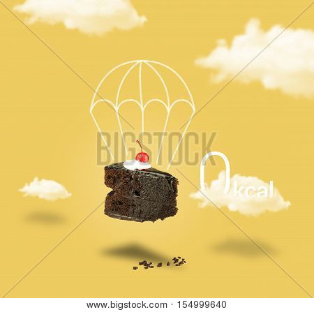 Isolated Chocolate cherry cake with parachute on yellow sky background. Chocolate cherry cake with parachute. Chocolate pie. Flying brownie with cream.