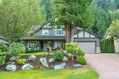 Big custom made luxury house with nicely trimmed and landscaped front yard in the suburb of Vancouve poster