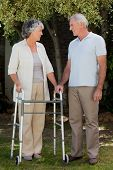 pic of zimmer frame  - Man with his wife in the garden - JPG