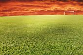 foto of football field  - Football field with dynamic sky above - JPG