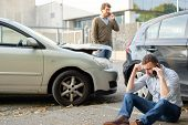 Two Men Calling Car Help Assistance After An Accident poster