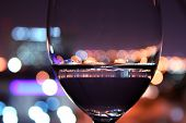 image of wine-glass  - outdoors Wine Glass With Blurred Lights water  - JPG