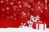 Christmas background with snow and gift box with red ribbon. White snowflakes and red xmas ball with poster