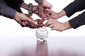 foto of save money  - Many hands saving money in the piggy bank - JPG