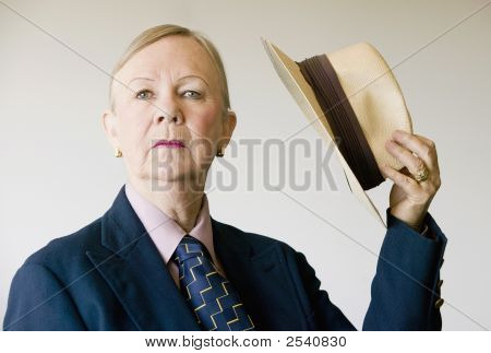 Dramatic Senior Woman With A Hat