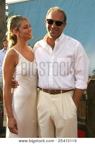 LOS ANGELES - AUG 11: Kevin Costner; fiance Christine Baumgartner at the 'Open Range' premiere on August 11, 2003 in Los Angeles, California