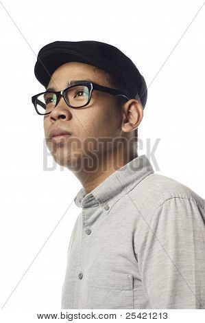 Asian malay man looking up to side