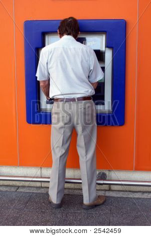 Man At Atm Or Hole In Wall Getting Money Out/Using Cash Machine.