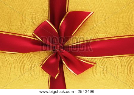 Close Up Of The Gift Box With Red Ribbon