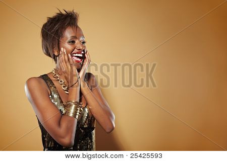 Smiling african woman looking surprised