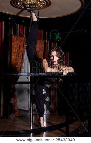 Sexy girl doing split on pole dance