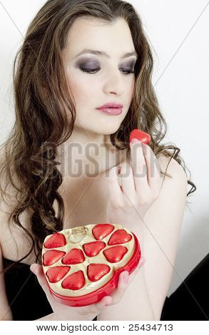 portrait of young woman with Valentine?s chocolate box