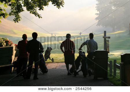 Golfers Begin Their Game.